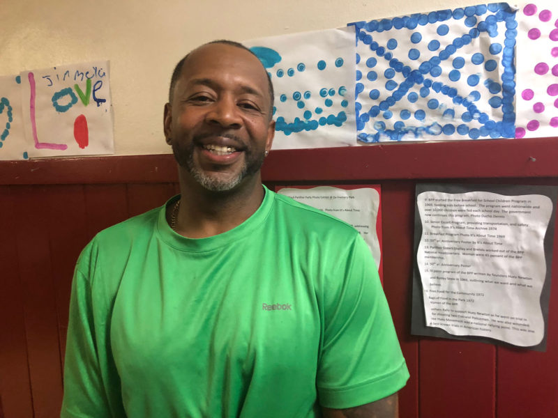 Mosi Zuberi stands in the hallway of the DeFremery Recreation Center after an Oakland REACH meeting.