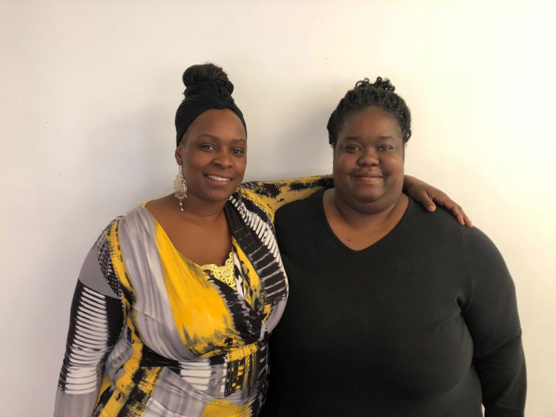 Shoniqua Kemp, left, and her friend LaTonya Peterson inside the Detroit Parent Network building.