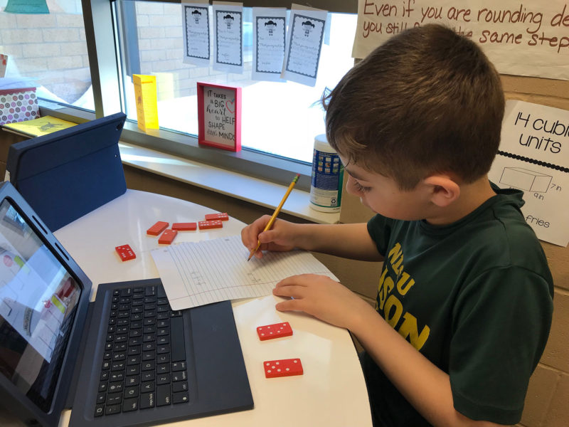 Northern Cass student Myles Froehlich works out fractions with the help of dominoes.