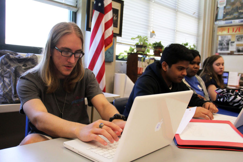 Students work on an assignment in a high school civics class. Some critics are raising concern about the qualifications of teachers in so-called dual-enrollment programs where students earn college credit while in high school; the national faculty union is planning a report that questions the quality of some of these programs.