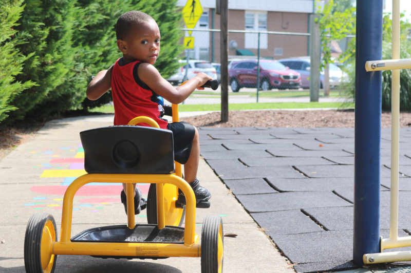 Riley Richardson rides a bike during a playgroup in Rocky Mount, North Carolina in June. The playgroup program gives children from birth to 5 years old who are not enrolled in preschool a chance to interact with others before kindergarten.