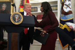 U.S. President Donald Trump listens to then-Director of Communications for the White House Public Liaison Office Omarosa Manigault during an event in the Oval Office of the White House October 24, 2017 in Washington, DC.