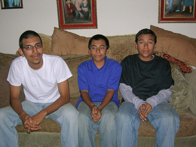 Mario Martinez in 2009, at home with his younger brothers Geovanni (middle) and Manuel.
