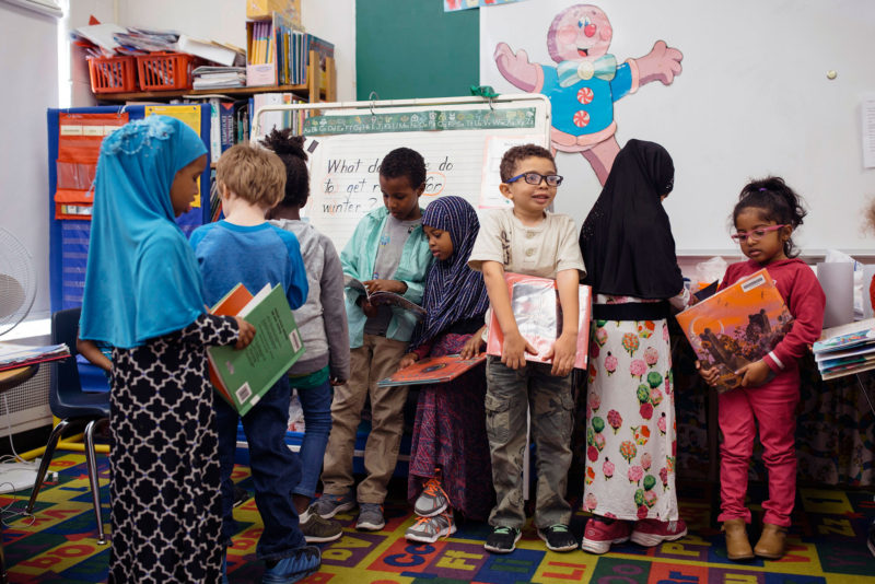 Students line up with their books for library in a kindergarten class in Maine. This school's demographic make-up has changed dramatically in the past decade, over 70 percent of its students are English Language Learners.