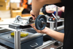 Students at Walker Valley High School in Cleveland, Tennessee, work with machinery in the school's mechatronics lab.