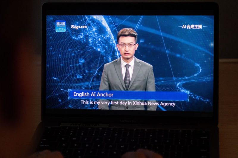 A man watches an artificial intelligence (AI) news anchor from a state-controlled news broadcaster, on his computer in Beijing on November 9, 2018. - China's state-controlled news broadcasters have long been considered somewhat robotic in their daily recitation of pro-government propaganda, and a pair of new presenters will do little to dispel that view.