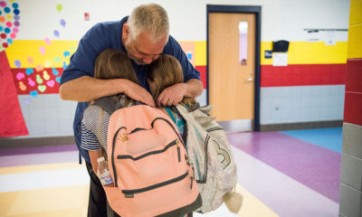 Greg Cruey, a teacher at Southside K-8 school, greeting students in the morning.