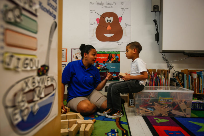 Linessa Barnhart, an assistant teacher at the Guadalupe Center, plays with Ryann Rijo, 5, in Immokalee, Florida.