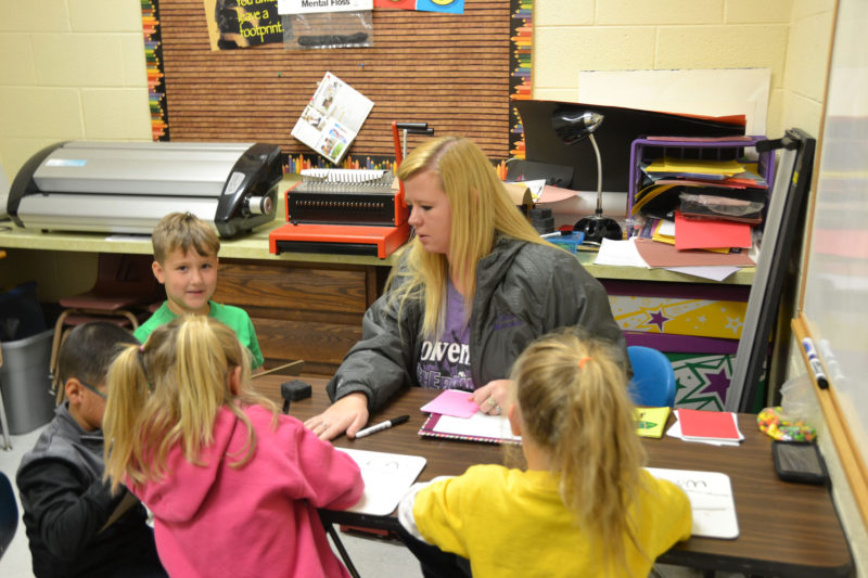 Kindergarteners get help with reading in Cheraw, Colorado. The district is working to improve results at its elementary school, which has been underperforming.