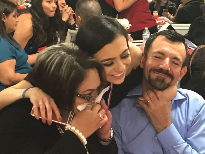 Julia Gomez-Delgado hugs her parents after telling them how grateful she is for their support.