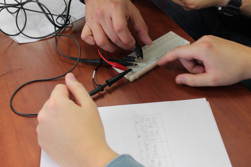 Students try to get their oscilloscopes to work in a course on electronics at Texas State Technical College.