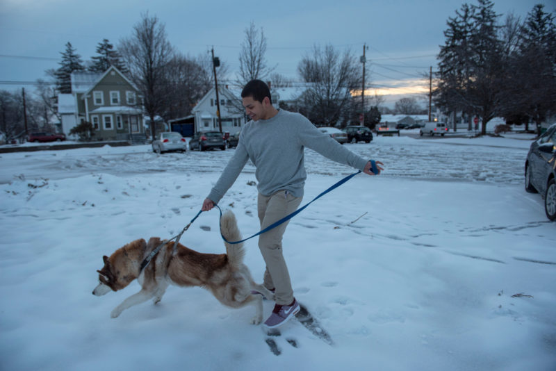 Ben Lara, a senior at Lowell High School, walks his dog before school. His dream is to become a business owner.