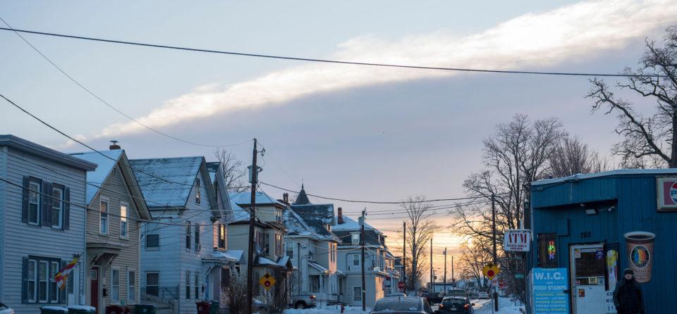 The sun rises over Branch Street in Lowell, Massachusetts.