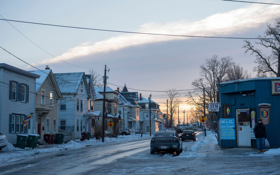 The sun rises over Branch Street in Lowell, Massachusetts.