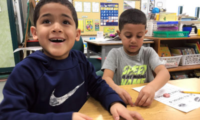 Full-day kindergarten students Januel Soto and Guijermo Rodriguez work on drawing pictures as part of a writing workshop project at Dr. Norman W. Crisp Elementary School in Nashua, New Hampshire.