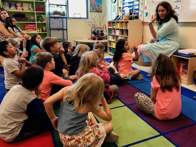 Teacher Jennifer Callahan explains the concept of a gentle force moving an object a short distance to her 21 kindergartners at the Redmond Early Learning Center in Redmond, Oregon.