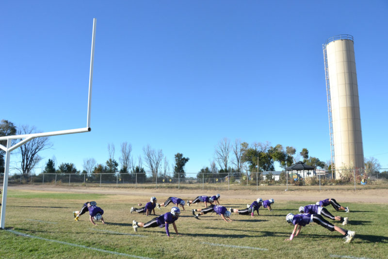 High schoolers practice on the football field in Cheraw, Colorado, a century-old town whose economy is based primarily around agriculture.