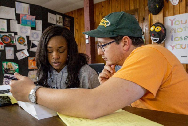 Rosedale Freedom Project Director of Operations Lucas Rapisarda, right, helps Kasha Williams, 17, with work during an early November session at Rosedale Freedom Project in Rosedale.