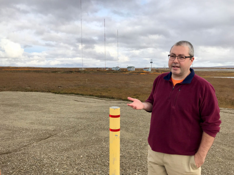 Jacob Phillips, Nome Public Schools' director of technology, stands at the site on the edge of town where Quintillion's new fiber-optic cable is buried.
