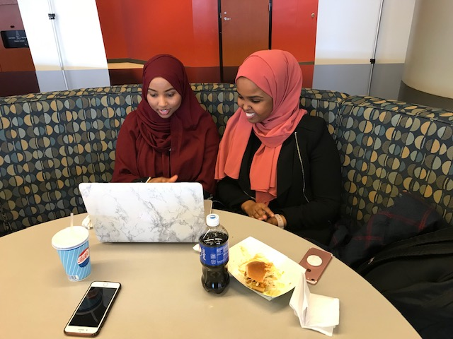 Students study over lunch at St. Paul College.