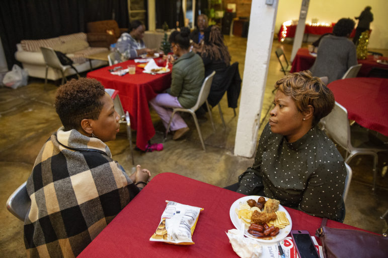 Adrienne Hudson, left, discusses education-related issues with Jo Blake, an instructor with Core Civic, during the RISE Teacher's Night Out at the Crossroads Cultural Arts Center in Clarksdale, Mississippi last December.