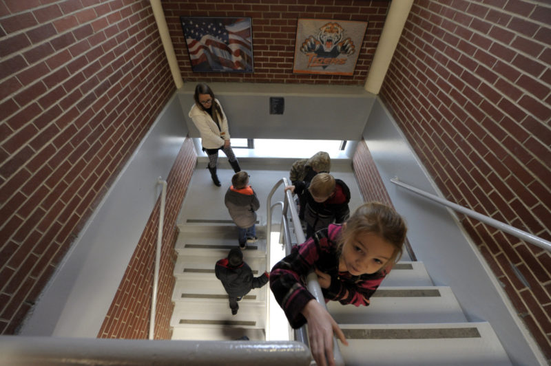 Kindergarten students are escorted to the second-floor music room at Atchison County Community Elementary School. The district required a waiver from the state fire code, which prohibits younger children from being taught above the first floor.