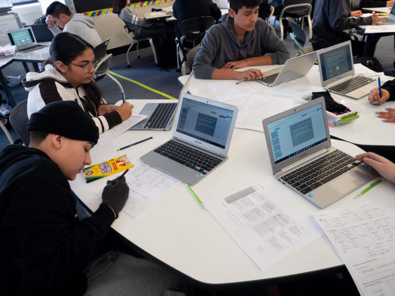 In a combined biology/literature class, students at James Lick High School complete assignments using school-supplied Chromebooks.