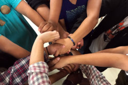 "Taos High students work together to untie a ""human knot"" during an icebreaker led by seniors during the school's 2018 EQ Retreat."