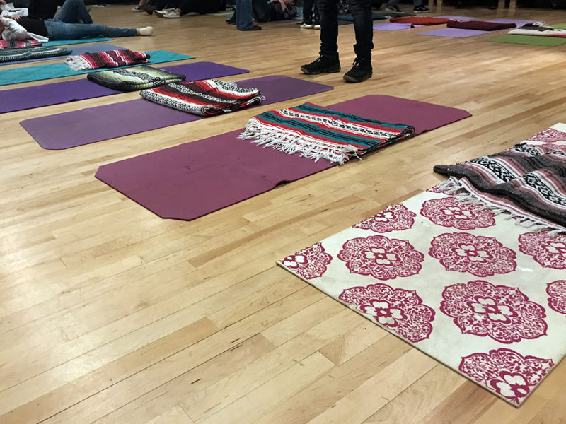 Yoga mats are lined up in the theater room at Taos High ahead of a meditation activity meant to help students develop new skills to deal with grief and loss.