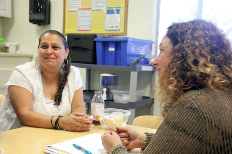 Linda Aguilar, director of a Kidango child care center in San Jose, meets with Chally Grundwag as part of the center's early childhood mental health consultation program.