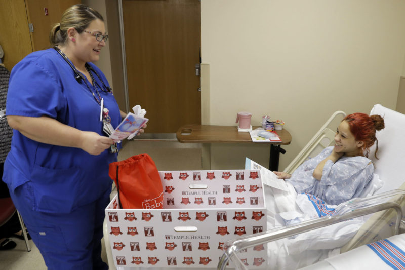 A registered nurse speaks with a new mother before her discharge from Temple University Hospital in Philadelphia. The proportion of nurses with bachelor's degrees is up from 44 percent to 57 percent since 2004, but still far short of the goal of reaching 80 percent by next year set by the Institute of Medicine to deal with the increasing complexity of healthcare.