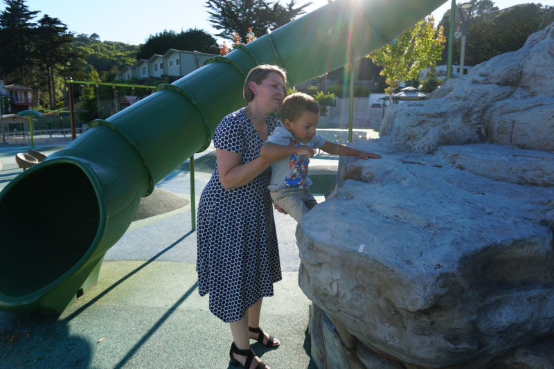 Lynette Stewart lifts her son Quincy, 3, up to a rock at George Rocky Graham Park in Marin City, California.