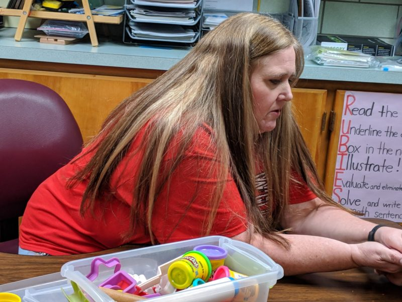 Lisa Cleland works with a student in her special education classroom at Washington Elementary School in Lamar, Colorado.