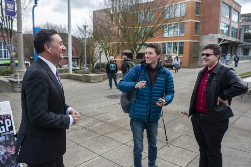 University of Washington-Tacoma Dean of Students Ed Mirecki, left, talks with Armen Papyan, president of the student government, and Daniel Eatherly, its director of legislative affairs. Students at the university pushed the administration to help their homeless classmates find places to live.