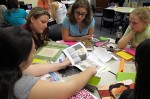 University of Central Florida elementary education students discuss how to incorporate books, maps, magazines and other materials into lesson plans. John O'Connor/StateImpact Florida. (Photo by Sarah Butrymowicz)