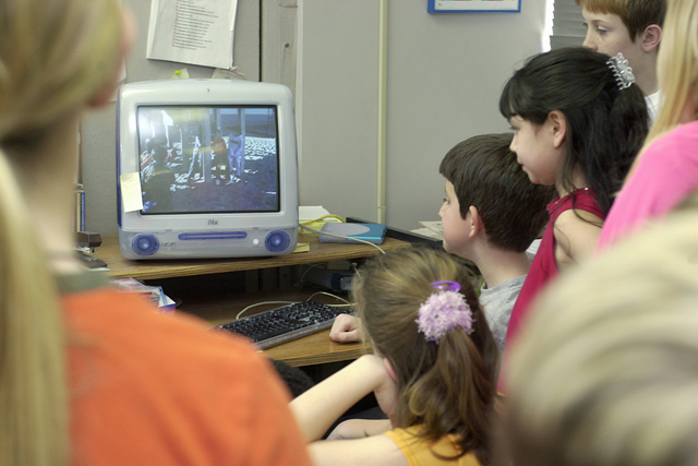 Woodland Park fourth grade students near Norfolk, Neb., watch a video in class. (AP Photo/Norfolk Daily News, Dennis Meyer)