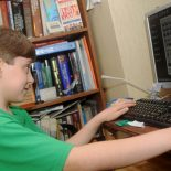 In a file photo, fifth-grader Andrew Riachi, 11, looks through his inventory while playing a game of Minecraft on a computer he built himself, in Pittsburg, Kan. (AP Photo/The Joplin Globe, Roger Nomer)