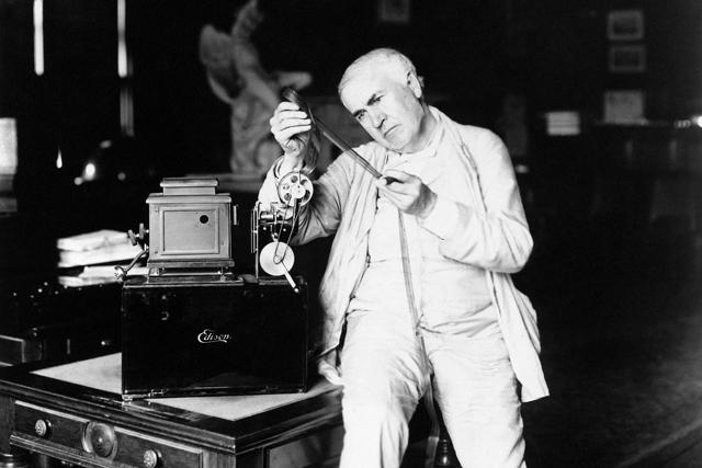Inventor Thomas A. Edison examines film. (AP Photo)