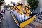 Members of the Jackie Robinson West Little League team from Chicago, Ill., ride in the Little League Grand Slam Parade as it makes its way through downtown Williamsport, Pa., Wednesday, Aug. 13, 2014. The Little League World Series tournament begins Thursday, August 14, in South Williamsport, Pa.. (AP Photo/Gene J. Puskar)