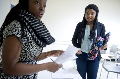 At right, high school senior, Adaugo Ezike, speaks with instructor Adetoro Adegbola after an essay writing course through Columbia University's State Pre-College Enrichment Program (S-PREP) at the Hammer Health Science Center on campus on November 23, 2013 in New York, New York. Adaugo is currently a student at New Rochelle High School in New York. (Photo: Ann Hermes/The Christian Science Monitor/No reproduction)
