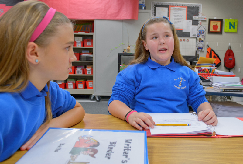 Belle Chasse Primary School 4th graders Bella Gross, and Julianna Shipp, talk about a reading passage from their writer's binders to determine if the passage was written in First, Second, or Third Person point of view in Belle Chasse, La. Thursday, April 3, 2014. (Photo: MATTHEW HINTON/Advocate)