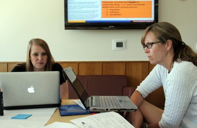 Kristina Smith and Sabra Miller discuss the new state math standards during a June training at Fort Lewis College. (Photo: Jackie Mader)