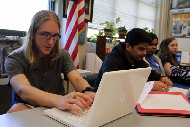 Zachary Schilling works on a report in McComb High School's Local Cultures elective course, which explores local civil rights figures and events. (Photo: Jackie Mader)