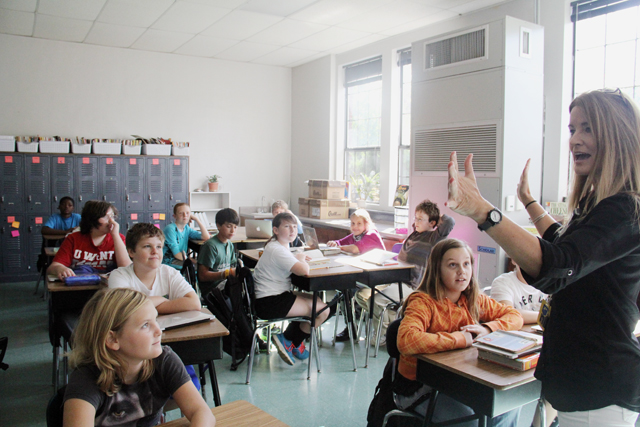 Fifth-grade teacher Michele Downey gives directions to her class. Downey said teachers have evolved in their ability to use technology in meaningful ways. (Photo by Jackie Mader)