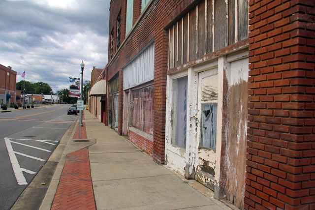 One of the main streets in downtown Piedmont, Alabama, which has lost thousands of jobs in recent years as factories have closed and moved elsewhere. (Photo by Jackie Mader)