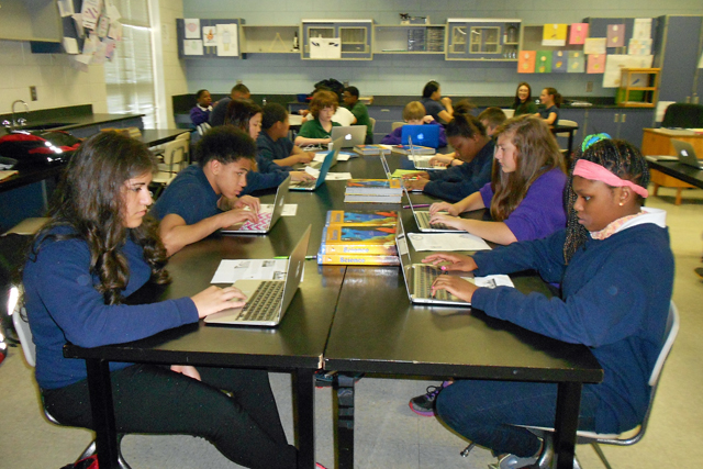 East Iredell students work on laptops during science class. (Photo: Margaret Ramirez)