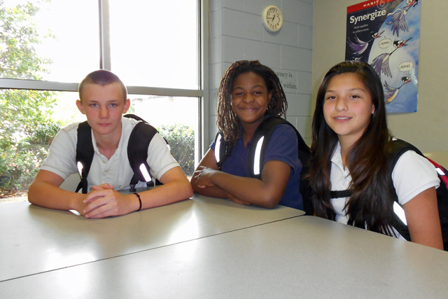 East Iredell Middle School students Andrew Johnson, Iyana James and Michell Fandino have all shown academic improvement in different subject areas since laptops were distributed this year by the Iredell-Statesville School District. (Photo: Margaret Ramirez)