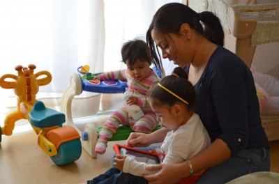 Duprey shows daughter Allison how to play a game on her tablet. (Photos by Jennifer Dev)