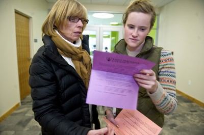 At right, Haleigh Doherty and her mother, Margaret Doherty, listen to college sophomore Rachel Sanborn, left, as she give a campus tour during Saint Michael's College Fall Academic Preview Day on November 9, 2013 in Colchester, Vermont. Haleigh is a high school senior who will soon have to make her choice on which college to attend. While keeping her choices primarily to the East Coast, Saint Michael's is the second college in Vermont that Haleigh visited. (Photo: Ann Hermes/The Christian Science Monitor)
