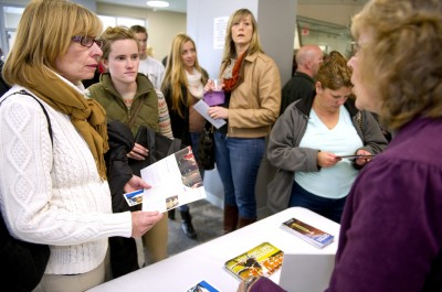 Margaret Doherty and her daughter Haleigh Doherty, speak to a financial aid representative during Saint Michael's College Fall Academic Preview Day on November 9, 2013 in Colchester, Vermont. Haleigh is a high school senior who will soon have to make her choice on which college to attend. While keeping her choices primarily to the East Coast, Saint Michael's is the second college in Vermont that Haleigh visited. (Photo: Ann Hermes/The Christian Science Monitor)